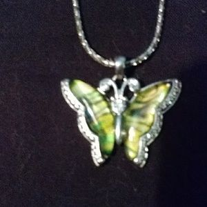 Silvertone necklace with a butterfly pendant